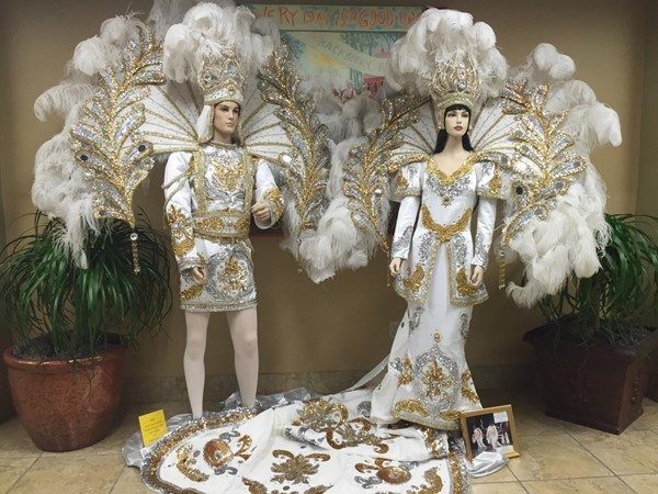Lake Charles Visitors Center showcasing Mardi Gras King and Queen costumes