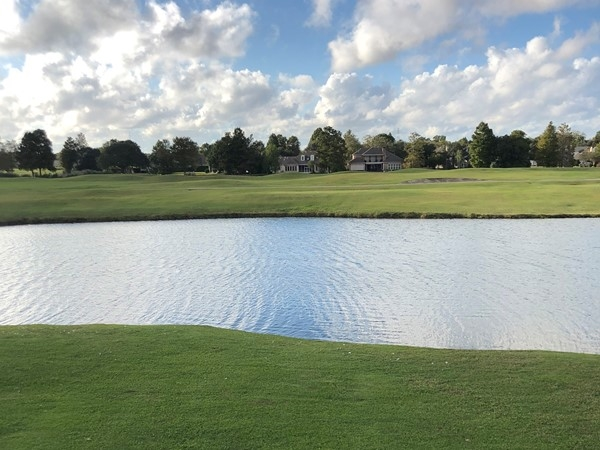 Views of the golf course from a condo unit in English Turn