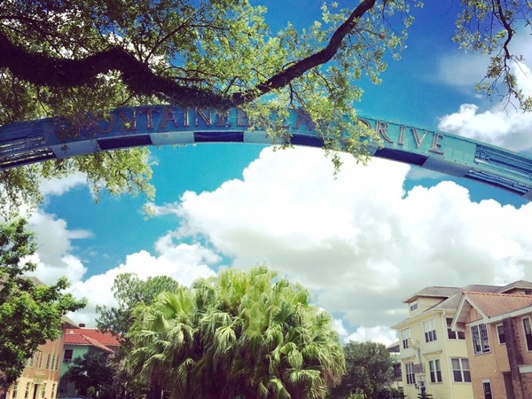 The landmark blue archway at the entrance to tree-lined Fontainebleau Drive