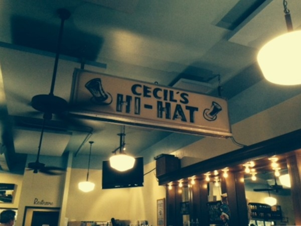 Cecil's Hi-Hat sign hanging above the bar at The High Hat Cafe