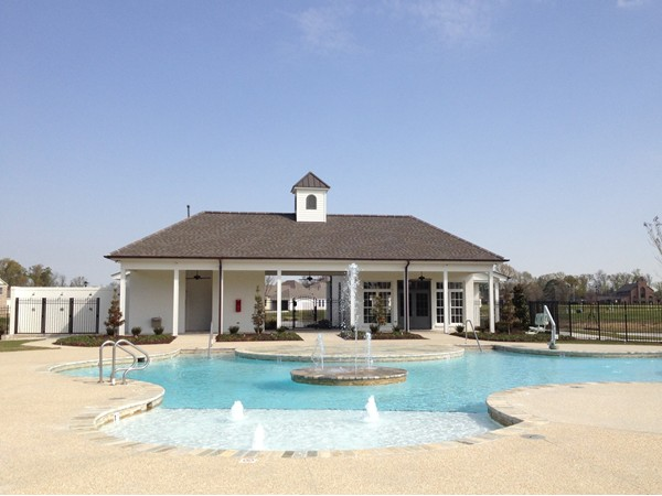 A pool view of the Long Farm Village Clubhouse