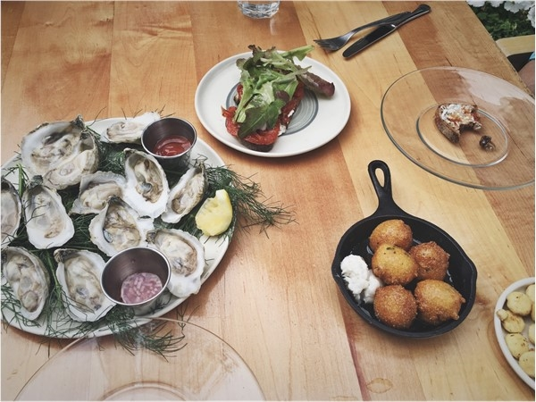 Oysters, Hushpuppies, and Roast Tomato and Goat Cheese Toast from Cavan